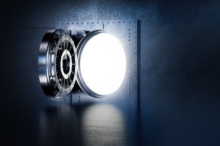 White light pours through the open door of a large safe